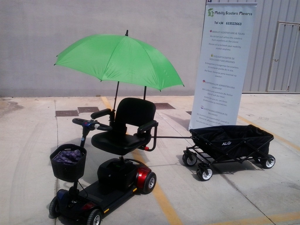 beach carts with mobility scooter and banner